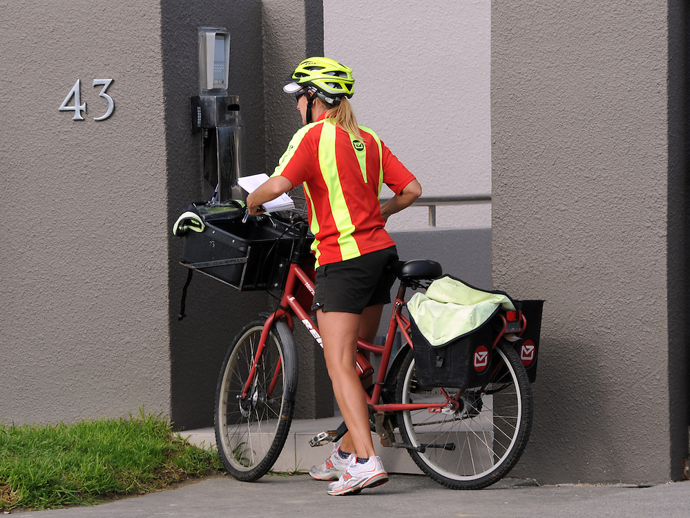 Postie, postman, post woman, mail delivery, post bike, Milford, Auckland, New Zealand, Tuesday, June 11, 2013. Credit:SNPA / Ross Setford