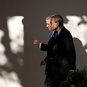 Advisor to President-elect Obama, John Podesta, foreground, talks with White House Chief of Staff Josh Bolten as Pres. Bush and President-elect Barack Obama walk along the collonade of the White House Monday, November 11, 2008...Photo by Khue Bui