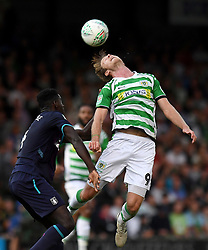 Aston Villa's Axel Tuanzebe and Yeovil Town's Alex Fisher during the Carabao Cup, First Round match at Huish Park, Yeovil.