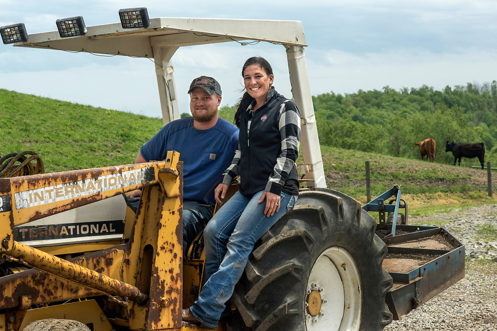 Carmichaels, PA, May 4, 2017:  Pro golfer Rachel Rohanna with her husband Ethan Virgili on the tractor they use to move feed for their beef cattle at Oak Hills Farm in Greene County, PA. The couple met at a high school sports banquet. ( Martha Rial for espnW)