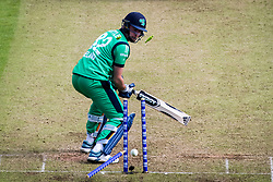 Ireland's Josh Little is bowled out by England's Tom Curran during the One Day International match at Malahide Cricket Club, Dublin.
