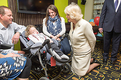 In the image -  The Duchess with 2 yr old Jacob Webb.<br /> HRH The Duchess of Cornwall, Patron of Helen & Douglas House Hospice visits Douglas House to celebrate their 10th Anniversary. The Hospice cares for children and young adults with life shortening conditions, United Kingdom, Friday, 9th May 2014. Picture by i-Images
