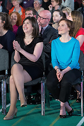 © Licensed to London News Pictures . 12/05/2014 . Manchester , UK . Lucy Powell (MP for Manchester Central) and Justin Thornton (Ed Miliband's wife) in the audience . The leader of the Labour Party , ED MILIBAND , delivers a speech on health at the National Squash Centre in Manchester today (Monday 12th May 2014) . Photo credit : Joel Goodman/LNP