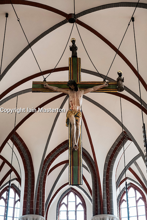 Christ on Crucifix inside Nikolai Church in Nikolaiviertel historic district in Mitte, Berlin, Germany