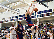 Carlos Lopez scores in Findlay Prep's victory over Oak Hill Academy in the 2009 ESPN Rise National High School Invitational Tournament.