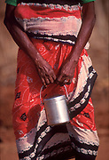 Sri Lanka. Woman and lunch pail at Udappuwa.