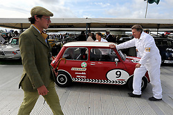 © Licensed to London News Pictures. 17/09/2011. GOODWOOD, UK. A mini is pushed back into it's position in it's garage. The Goodwood Revival at Goodwood in West Sussex today (17 September 2011). The revival is the world's largest historic motor race meeting, which relieves the 'glorious' days of the race circuit. Competitors and enthusiasts all dress in period fashion to enhance the experience. Photo credit : Stephen Simpson/LNP
