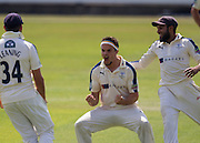 Jack Brooks celebrates with team mates Adil U Rashid  and Jack Leaning (34) (Yorkshire CCC)  after taking the wicket of Jamie Harrison (Durham County Cricket Club) during the LV County Championship Div 1 match between Durham County Cricket Club and Yorkshire County Cricket Club at the Emirates Durham ICG Ground, Chester-le-Street, United Kingdom on 1 July 2015. Photo by George Ledger.
