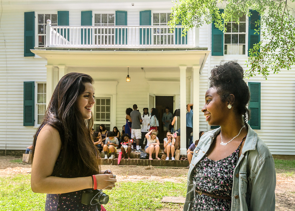 Amalia Olvera Huerta and Annie Taylor talk outside Rowan Oak, the home of author William Faulkner, May 30, 2015, in Oxford, Mississippi. The two high school juniors, along with 120 other students, toured the home as part of the University of Mississippi's Summer College for High School Students. (Photo by Carmen K. Sisson/Cloudybright)