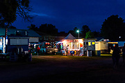 The Candy Man food vendor cart closes for the night at the conclusion of the Monroe Balloons and Blues Festival at the Green County fairgrounds in Monroe, Wis., during summer on June 18, 2016. (Photo by Jeff Miller, www.jeffmillerphotography.com)