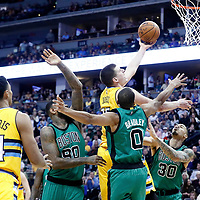 10 March 2017: Denver Nuggets forward Nikola Jokic (15) goes for the layup past Boston Celtics forward Amir Johnson (90), Boston Celtics guard Avery Bradley (0) and Boston Celtics forward Gerald Green (30) during the Denver Nuggets 119-99 victory over the Boston Celtics, at the Pepsi Center, Denver, Colorado, USA.