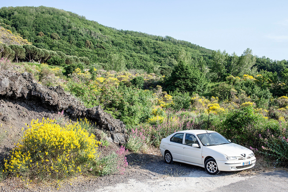 22 May 2017, San Vito, Ercolano, Naples Italy - A car parked near a block of lava inside the National Park of the Vesuvius.