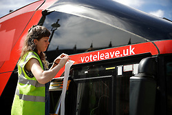 "© Licensed to London News Pictures. 18/07/2016. London, UK. The wording ""voteleave.uk"" being covered up with tape. A bus used by the Leave campaign during the EU referendum, rebranded by Greenpeace outside the Houses of Parliament in London. The ""Brexit Bus"" was previously covered in a slogan claiming that £350 million sent to the EU could be spent on the NHS.  Photo credit: Peter Macdiarmid/LNP"
