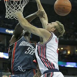 10 December 2008:  Charlotte Bobcats center Emeka Okafor (50) rejects the shot of New Orleans Hornets forward Sean Marks (4) during a NBA regular season game between the Charlotte Bobcats and the New Orleans Hornets at the New Orleans Arena in New Orleans, LA. The game was an NBA Hardwood Classic with the Hornets dressed out in throwback uniforms honoring the former ABA franchise the New Orleans Buccaneers..