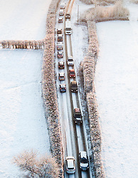 © Licensed to London News Pictures. 28/02/2018. Leatherhead, UK. As more snow fell overnight traffic backs up on a road near Fetcham after an accident. Further disruption is expected today as the so called Beast from the East weather front continues to affect the UK. Photo credit: Peter Macdiarmid/LNP