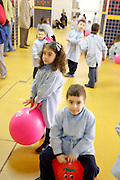 LEBANON, BEIRUT:  Five-year-olds exercising with exercise balls with their kindergarten class in a Beirut school.
