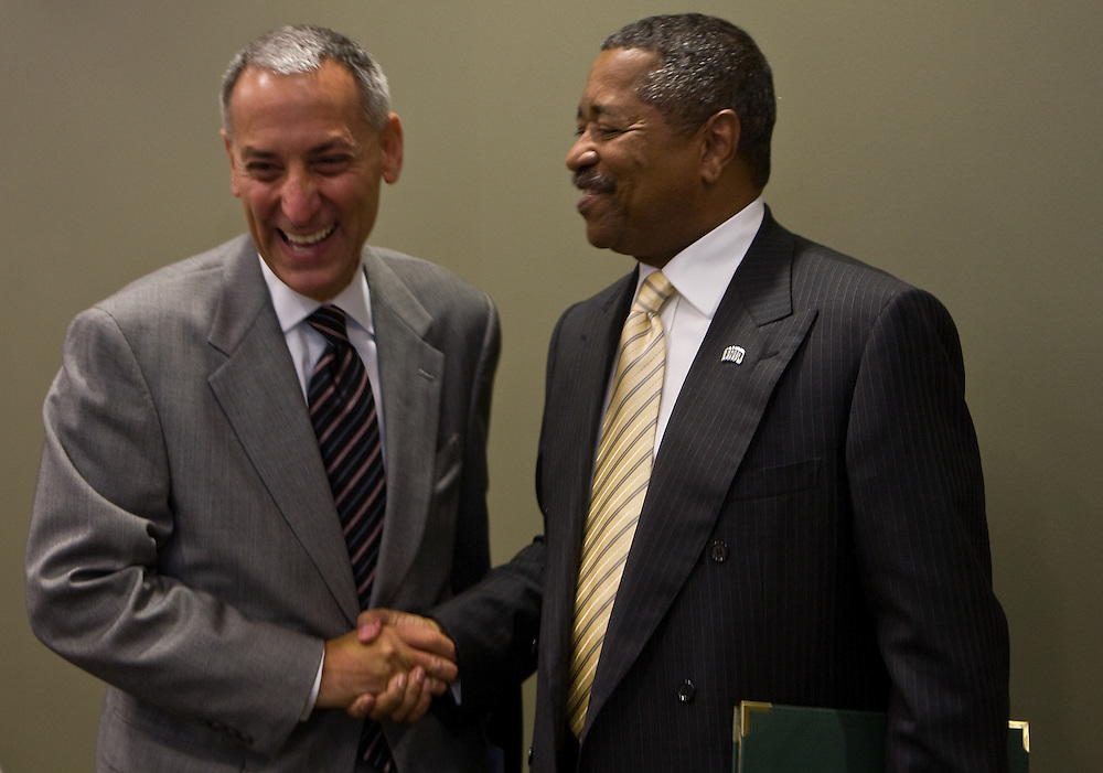 (from left) During his visit to the Faculty Senate in Walter Hall, Chancellor Eric D. Fingerhut, the seventh Chancellor of the Ohio Board of Regents, greets Ohio University president, Roderick McDavis, on Monday night, September 8, 2008.