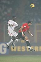 Photo: Steve Bond/Richard Lane Photography.<br />Egypt v Sudan. Africa Cup of Nations. 26/01/2008. Mohamed Shawky (R) gets in front of Omer Mohamed (L) in the smoke of Kumasi