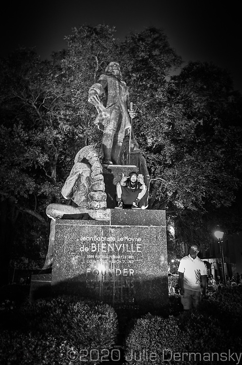 Protester  on the Bienville Monument in New Orleans on June 27, 2020., during a protest held by Take 'Em Down NOLA in  in New Orleans.