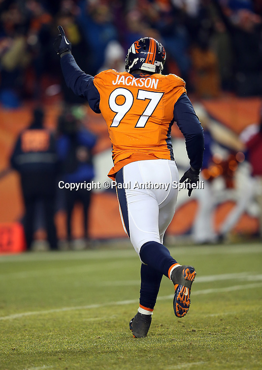 Denver Broncos defensive end Malik Jackson (97) runs, points, and celebrates after Denver Broncos outside linebacker DeMarcus Ware (94) recovers a fumbled snap in overtime, clinching a Broncos win during the 2015 NFL week 16 regular season football game against the Cincinnati Bengals on Monday, Dec. 28, 2015 in Denver. The Broncos won the game in overtime 20-17. (©Paul Anthony Spinelli)