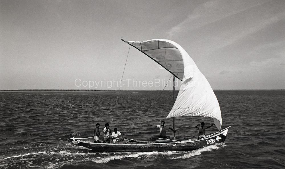 Sri Lanka. Jaffna. Fishing boat arriving at Jaffna harbour pier, near the city.<br /> 1998