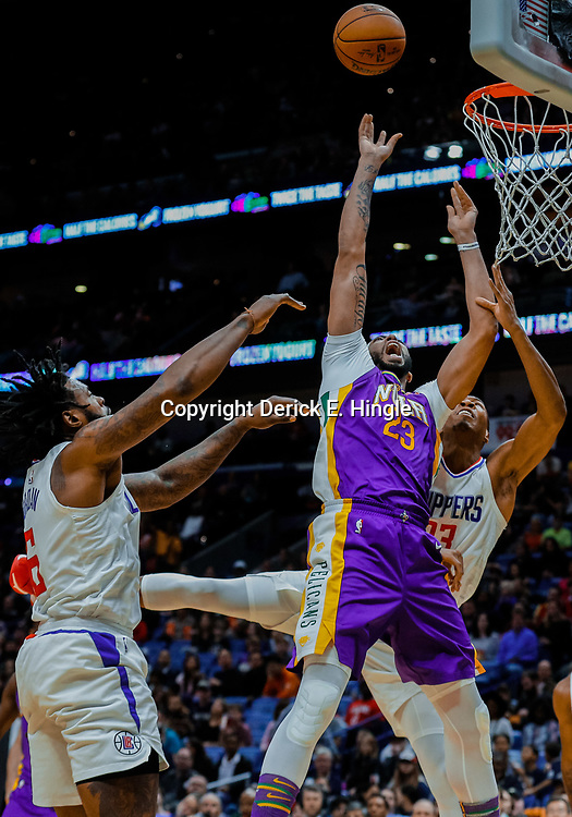 Jan 28, 2018; New Orleans, LA, USA; New Orleans Pelicans forward Anthony Davis (23) shoots as LA Clippers center DeAndre Jordan (6) and forward Wesley Johnson (33) defend during the third quarter at the Smoothie King Center. The Clippers defeated the Pelicans 112-103. Mandatory Credit: Derick E. Hingle-USA TODAY Sports