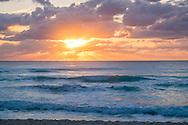 Sunrise over the Caribbean sea in Cancun, Mexico.