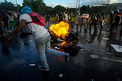June 22, 2017 - Caracas, Capital District, Venezuela - Demonstrators set fire to a motorcycle of the Bolivarian National Police (PNB) in a protest against the government of Nicolas Maduro this June 22, 2017 in Caracas, Venezuela. (Credit Image: © Adrian Manzol via ZUMA Wire)