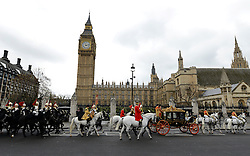 © Licensed to London News Pictures. 09/05/2012. Westminster, UK The procession carrying Queen Elizabeth II on its way to the Palace of Westminster today 9th May 2012. It is the first Queen's Speech, the grandest event on the parliamentary calendar, since shortly after the coalition Government was formed. The statement usually takes place each autumn. Photo credit : Stephen Simpson/LNP