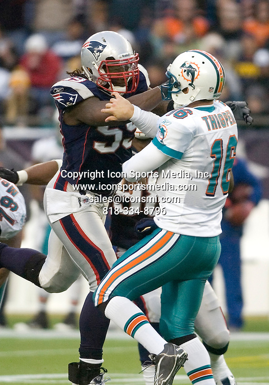 02 January 2011.  Patriot Linebacker Gary Guyton (59) putting pressure on Dolphins Quarterback Tyler Thigpen (16).  The New England Patriots defeated the Miami Dolphins 38 to 7 in a Sunday Afternoon game at Gillette Stadium in Foxboro, Massachusetts.