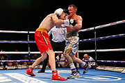 Josh Warrington lands a punch on Sofiane Takoucht during the Josh Warrington Sofiane Takoucht IBF featherweight title fight at First Direct Arena, Leeds, United Kingdom on 12 October 2019.