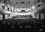 State Opening Of The National Concert Hall. (N92)..1981..09.09.1981..9th September 1981..The President ,Dr Patrick Hillery, officially opened the new National Concert Hall,Earlsfort Terrace, Dublin. The state opening was followed by the premier concert performed by the Radio Telefís Eireann Symphony Orchestra with a large cast of soloists, choirs and the RTESO leader Audrey Park and conducted by RTE's Principal conductor Colman Pearce...A view of the auditorium inside the National Concert Hall, image shows the RTESO and the massed choir on stage.