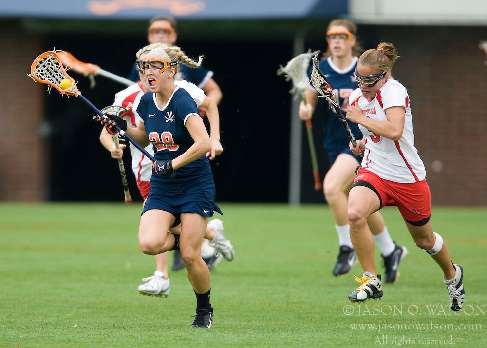 Virginia Cavaliers A Megan O'Malley (28) clears the ball against Maryland.  The #3 ranked Virginia Cavaliers defeated the #2 ranked Maryland Terrapins 10-9 in overtime in the finals of the Women's 2008 Atlantic Coast Conference Lacrosse tournament at the University of Virginia's Scott Stadium in Charlottesville, VA on April 27, 2008.