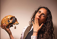 Paleoanthropologist and comedian Aalaa Al Shamahi holds the cast of a Neanderthal skull in her lab at the Anthropology Department of the University College London.   Wednesday, May 20, 2015 Al Shamahi who specialises in the study of Neanderthals is one of National Geographic's emerging explorers.(Elizabeth Dalziel for National Geographic )