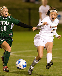 Virginia midfielder/defender Alli Fries (8) passes the ball past Loyola midfielder Theresa Ferraina (10).  The Virginia Cavaliers defeated the Loyola (MD) Greyhounds 4-1 in the first round of the NCAA Women's Soccer tournament held at Klockner Stadium in Charlottesville, VA on November 16, 2007.