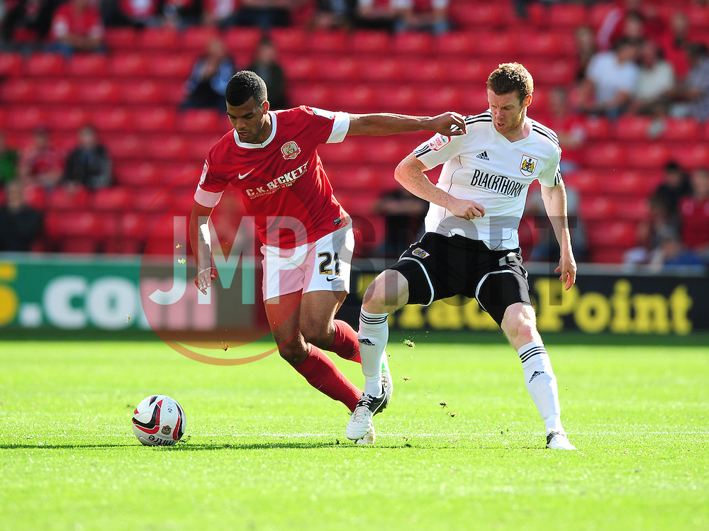 Barnsley's Jacob Mellis battles for the ball with Bristol City's Stephen Pearson - Photo mandatory by-line: Joe Meredith/Josephmeredith.com  - Tel: Mobile:07966 386802 01/09/2012 - Barnsley v Bristol City - SPORT - FOOTBALL - Championship -  Barnsley  - Oakwell Stadium -