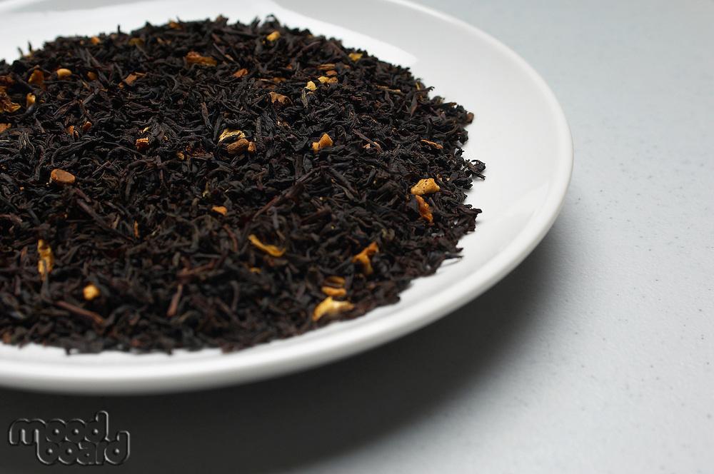 Dried tea leaves on plate