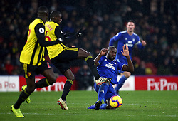 Cardiff City's Sol Bamba tackles Watford's Abdoulaye Doucoure during the Premier League match at Vicarage Road, Watford.