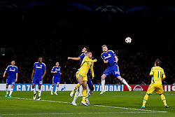 Andre Schurrle of Chelsea heads clear from Islam Slimani of Sporting - Photo mandatory by-line: Rogan Thomson/JMP - 07966 386802 - 10/12/2014 - SPORT - FOOTBALL - London, England - Stamford Bridge - Sporting Clube de Portugal - UEFA Champions League Group G.