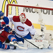May 22, 2014: Montreal Canadiens goalie Dustin Tokarski (35) stops New York Rangers left wing Rick Nash (61) as he crashes the net during game three of the Eastern Conference Finals between The New York Rangers and The Montreal Canadiens at  Madison Square Garden in Manhattan, New York .  Mandatory Credit: Kostas Lymperopoulos/Cal Sport Media, (Credit Image: © Kostas Lymperopoulos/Cal Sport Media)