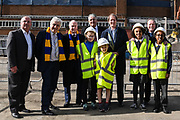 (left to right) Mike Watson from Galliard Homes, Council Leader Stephen Alambritis, AFC Wimbledon legend Ian Cooke, Victor Clinton-Dove from Catalyst, Chief Executive Erik Samuelson, AFC Wimbledon legend Dave Bassett, and children from both Smallwood Primary School and children from AFC Wimbledon player development programme during the AFC Wimbledon Demolition Event, marking the start of building works at the AFC Wimbledon Stadium Site, Plough Lane, United Kingdom on 16 March 2018. Picture by Stephen Wright.