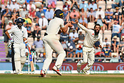 Wicket - Moeen Ali of England watches Alastair Cook of England take the catch to dismiss Virat Kohli (captain) of India during the 4th day of the 4th SpecSavers International Test Match 2018 match between England and India at the Ageas Bowl, Southampton, United Kingdom on 2 September 2018.