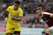 AFC Wimbledon striker Lyle Taylor (33) and Northampton Town defender Zander Diamond (5) in action during the EFL Sky Bet League 1 match between Northampton Town and AFC Wimbledon at Sixfields Stadium, Northampton, England on 20 August 2016. Photo by Stuart Butcher.