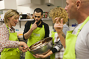 Carole and Jason Miller in the kitchen with 6 new recruits of Tinderbox at the Spark 2010 Pitching Event. Highpoint Conference Centre, Leicester