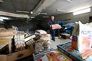 Naoto Matsumura carries food for pets and other animals he is caring for that were left behind in the government-imposed no-go zone about 10 km from the Fukushima Daiichi Nuclear Power Plant in Tomioka, Fukushima  Prefecture, Japan on 01 Mar. 2012. . .Photographer: Robert Gilhooly