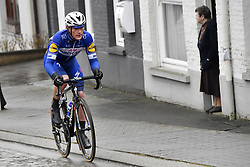 March 28, 2018 - Waregem, BELGIUM - Belgian Yves Lampaert of Quick-Step Floors passes a woman standing on her doorstep, during the 73rd edition of the 'Dwars Door Vlaanderen' cycling race, 180,1 km from Roeselare to Waregem, Wednesday 28 March 2018. BELGA PHOTO POOL PETER DE VOECHT (Credit Image: © Pool Peter De Voecht/Belga via ZUMA Press)