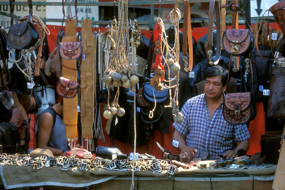 ARGENTINA/ BUENOS AIRES.  Feria Folklórica de Mataderos, llevada a cabo cada domingo en el barrio de Mataderos. En la imagen, puesto artesanía de cuero...ARGENTINA/ BUENOS AIRES. Mataderos Neighbourhood. Every sunday there is an Argentinian folk holiday. In the image, leather handicrafts stand
