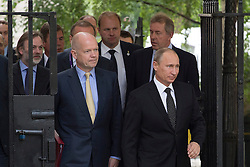 © licensed to London News Pictures. London, UK 16/06/2013. Russian President Vladimir Putin entering Downing Street from backdoor, due to an anti-Turkish government demonstration in Whitehall, for talks with David Cameron ahead of the G8 summit on Sunday, 16 June 2013. Photo credit: Tolga Akmen/LNP