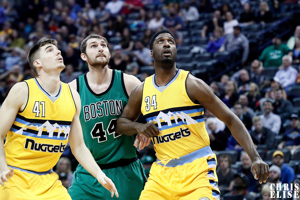 10 March 2017: Boston Celtics center Tyler Zeller (44) vies for the rebound with Denver Nuggets center Roy Hibbert (34) and Denver Nuggets forward Juancho Hernangomez (41) during the Denver Nuggets 119-99 victory over the Boston Celtics, at the Pepsi Center, Denver, Colorado, USA.