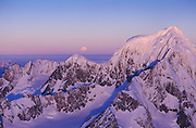 Full moon rising as sunset light catches Mt Tasman in Mt Cook National Park, New Zealand
